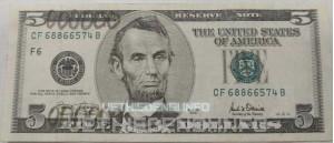 Поврежденная валюта. Доллар с надписями